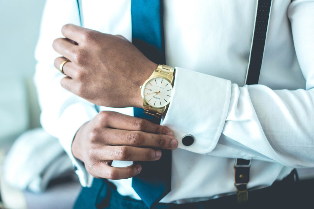 Man in suit with a luxury watch around the wrist