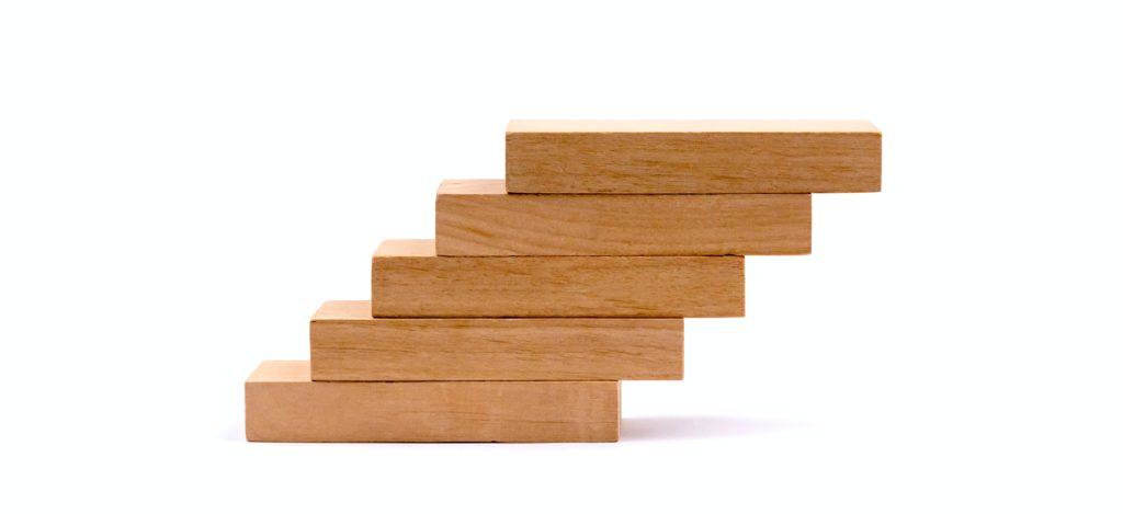 ascending pile of brown wooden blocks