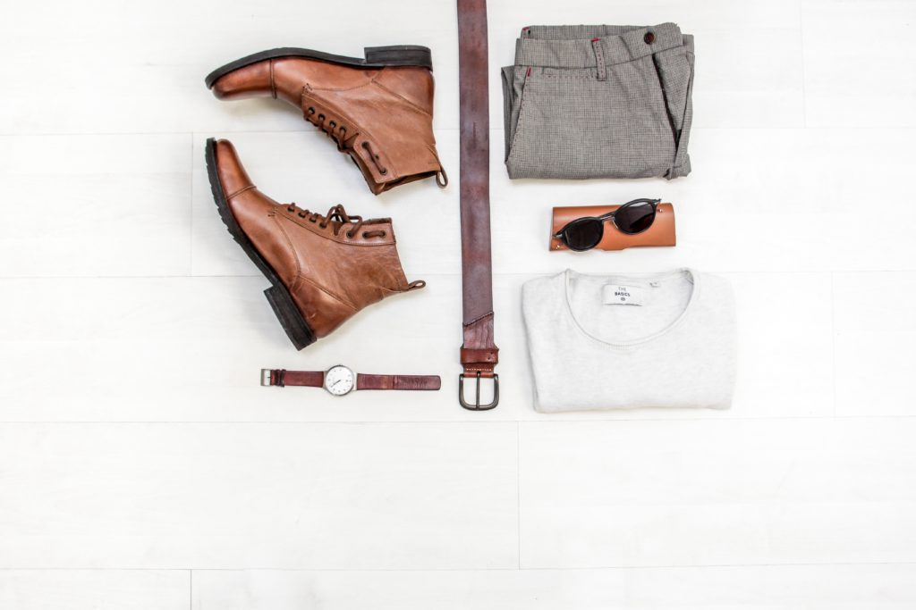 Different products: shoes, t-shirt, belt, trousers, sunglasses, watch